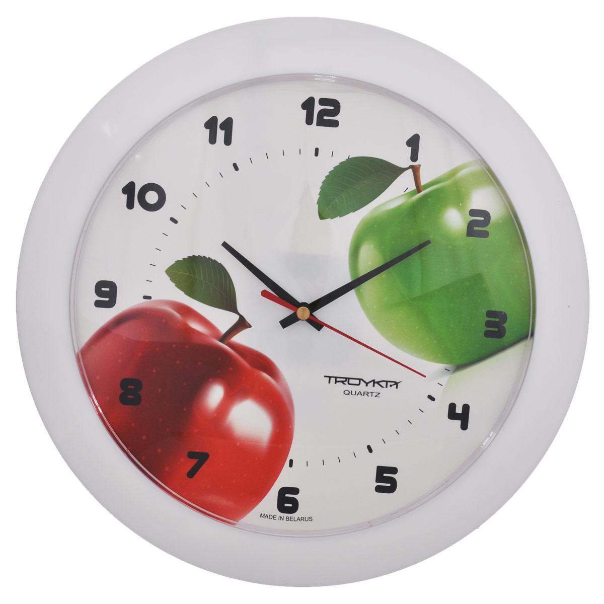 Часы настенные Troyka Яблоки, цвет: белый, красный, зеленый. 5151053351510533Настенные кварцевые часы Troyka Яблоки, изготовленные из пластика, прекрасно подойдут под интерьер вашего дома. Круглые часы имеют три стрелки: часовую, минутную и секундную, циферблат украшен изображением яблок и защищен прозрачным пластиком. Диаметр часов: 30,5 см. Часы работают от 1 батарейки типа АА напряжением 1,5 В (входит в комплект).
