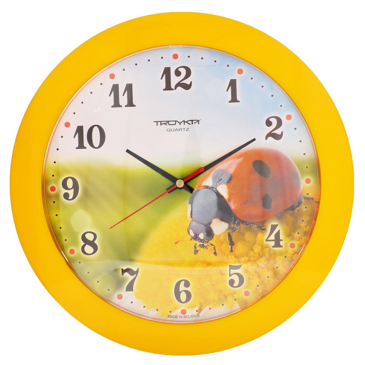 Часы настенные Troyka Божья коровка, цвет: красный, желтый, зеленый. 5155052251550522Настенные кварцевые часы Troyka Божья коровка, изготовленные из пластика, прекрасно подойдут под интерьер вашего дома. Круглые часы имеют три стрелки: часовую, минутную и секундную, циферблат украшен изображением божьей коровки и защищен прозрачным пластиком. Диаметр часов: 30,5 см. Часы работают от 1 батарейки типа АА напряжением 1,5 В (входит в комплект).