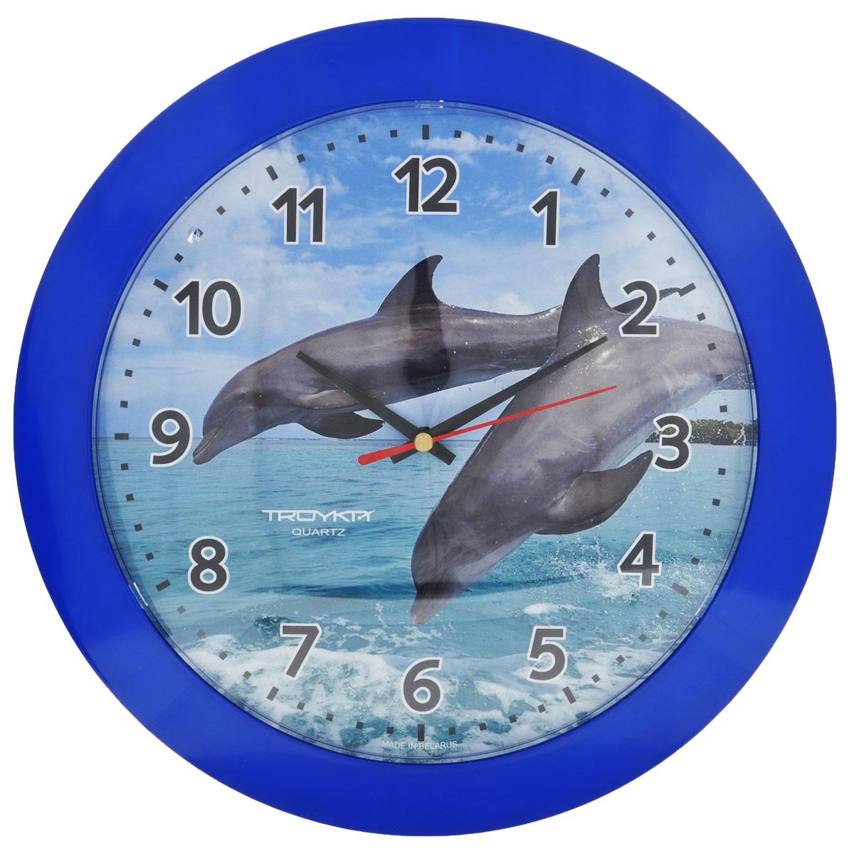 Часы настенные Troyka Дельфины, цвет: синий. 5154052051540520Настенные кварцевые часы Troyka Дельфины, изготовленные из пластика, прекрасно подойдут под интерьер вашего дома. Круглые часы имеют три стрелки: часовую, минутную и секундную, циферблат украшен изображением двух дельфинов и защищен прозрачным пластиком. Диаметр часов: 30,5 см. Часы работают от 1 батарейки типа АА напряжением 1,5 В (входит в комплект).