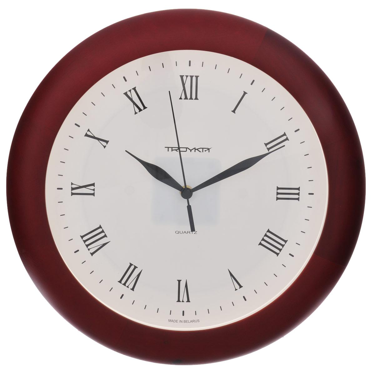 Часы настенные Troyka, цвет: белый, вишневый. 1116211511162115Настенные кварцевые часы с классическим дизайном Troyka, изготовленные из пластика, прекрасно подойдут под интерьер вашего дома. Круглые часы имеют три стрелки: часовую, минутную и секундную, циферблат защищен прозрачным пластиком. Диаметр часов: 30 см. Часы работают от 1 батарейки типа АА напряжением 1,5 В (входит в комплект).