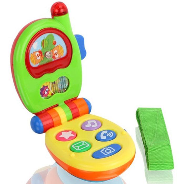 Музыкальная игрушка Малышарики Музыкальный телефонMSH0303-005Музыкальная игрушка Малышарики Музыкальная установка - это не только веселая, но и полезная игрушка для малыша. Она не позволит ему скучать и научит новому. С такой игрушкой малыш сможет познакомиться с миром звуков, а благодаря ярким световым и звуковым эффектам, игра будет еще интереснее. Игрушка выполнена из безопасного прочного пластика ярких цветов в виде складного мобильного телефона. На корпусе телефона расположены 5 кнопок, издающих звуки телефонного звонка, щелчок фотоаппарата или забавную мелодию при нажатии. На экране телефона находится картинка с малышами-Смешариками с подвижным элементом, который малыш сможет передвигать, закрывая одну или другую половину картинки. Выше располагается экран с картинкой, которая крутится при нажатии на кнопку справа. Во время игры антенна телефона будет мигать яркими огоньками. Игры с такой игрушкой развивают мелкую моторику, концентрацию внимания, творческие способности, слуховое восприятие и координацию движений малыша. ...