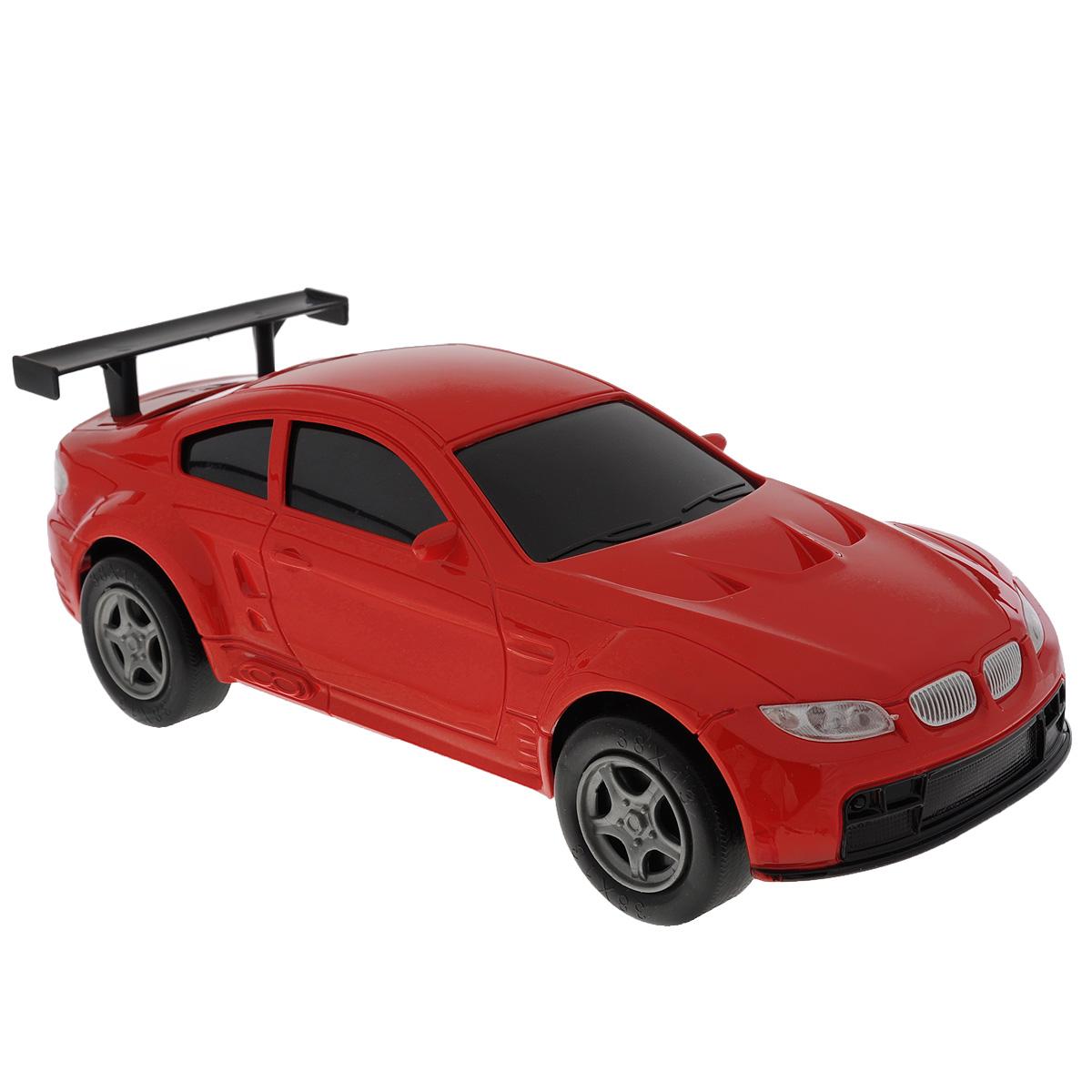 Машинка Пламенный мотор, цвет: красный87446_красныйИгрушечный автомобиль Пламенный мотор с инерционным механизмом обязательно понравится вашему малышу. Он привлечет внимание вашего ребенка и надолго останется его любимой игрушкой. Машинка выполнена из пластмассы с элементами металла. Благодаря инерционному механизму игрушка может двигаться самостоятельно, стоит только откатить машинку назад, а затем отпустить, и она поедет вперед.. Игрушка развивает концентрацию внимания, координацию движений, мелкую моторику рук, цветовое восприятие и воображение. Малыш будет в восторге от такого подарка!