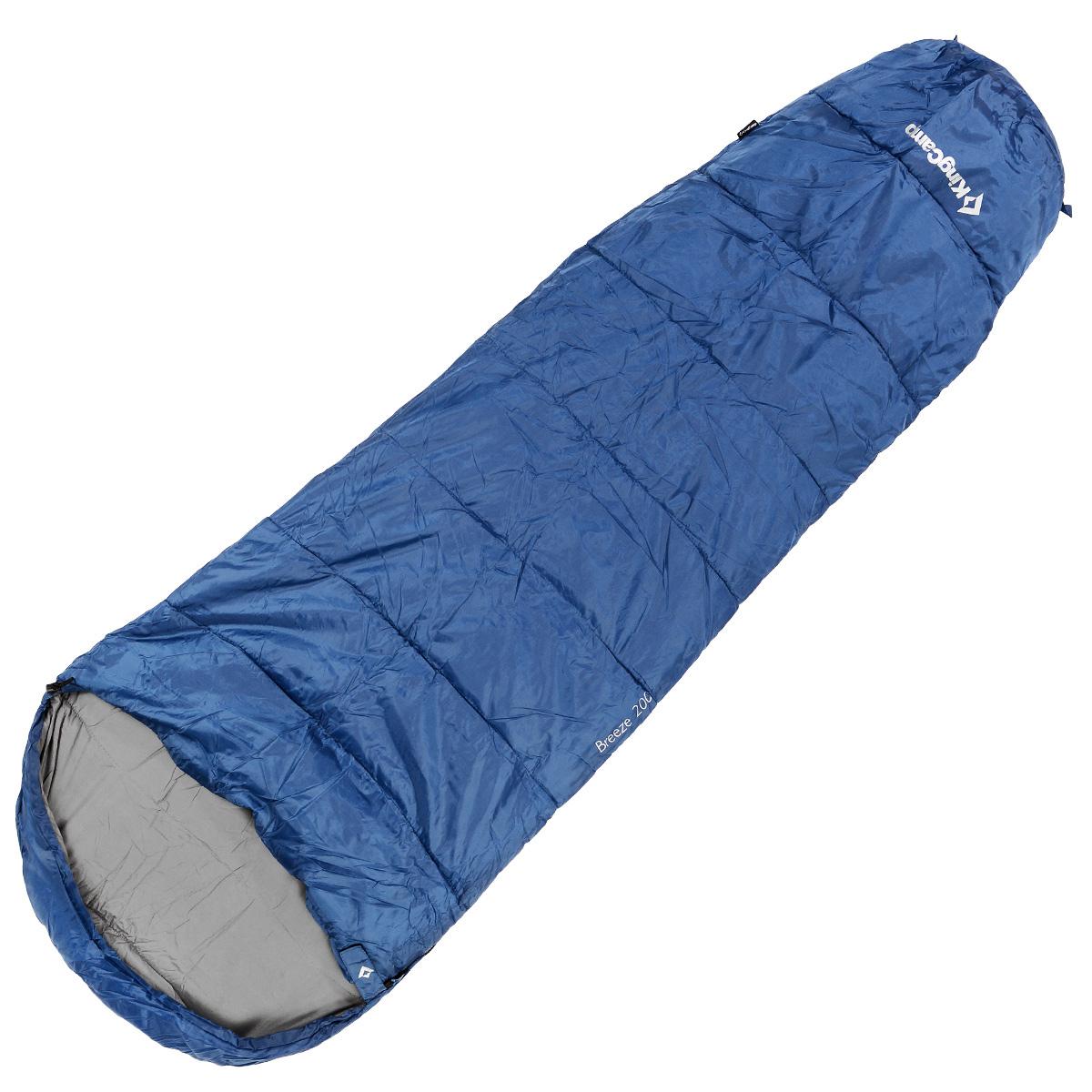 Спальный мешок-кокон KingCamp Breeze, цвет: синий, 215 см x 80 см х 55 см, правосторонняя молнияУТ-000050425Спальный мешок-кокон KingCamp Breeze предусмотрен как для лета, так и для прохладного времени года, так как рассчитан на температуру от -4°C до +11°С. Спальный мешок выполнен в форме кокона, имеет удобный подголовник. В сложенном виде спальный мешок занимает очень мало места и весит совсем немного. Оснащен удобным нейлоновым компрессионным мешком для переноски. Отлично подходит для летних походов, кемпинга, треккинга и велотуризма. Вес: 1,2 кг.