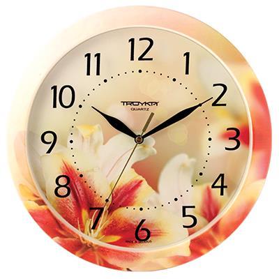 Часы настенные Troyka, цвет: желтый, красный, белый. 1100001811000018Настенные кварцевые часы Troyka с изображением лилий, изготовленные из пластика, прекрасно подойдут под интерьер вашего дома. Круглые часы имеют три стрелки: часовую, минутную и секундную, циферблат защищен прозрачным пластиком. Диаметр часов: 29 см. Часы работают от 1 батарейки типа АА напряжением 1,5 В. Внимание! Часы укомплектованы бесплатным тестовым элементом питания для обеспечения их работоспособности при предпродажной подготовке и демонстрации рабочих функций.