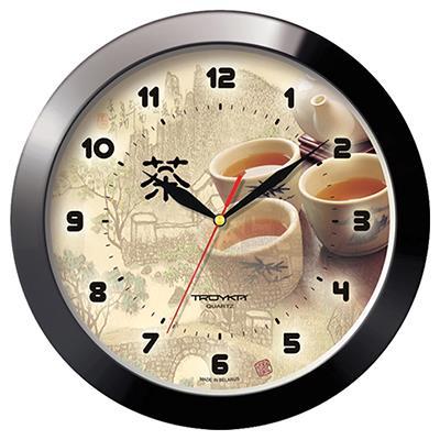 Часы настенные Troyka, цвет: черный. 1110018811100188Настенные кварцевые часы Troyka с изображением чайной церемонии, изготовленные из пластика, прекрасно подойдут под интерьер вашего дома. Круглые часы имеют три стрелки: часовую, минутную и секундную, циферблат защищен прозрачным пластиком. Диаметр часов: 29 см. Часы работают от 1 батарейки типа АА напряжением 1,5 В. Внимание! Часы укомплектованы бесплатным тестовым элементом питания для обеспечения их работоспособности при предпродажной подготовке и демонстрации рабочих функций.