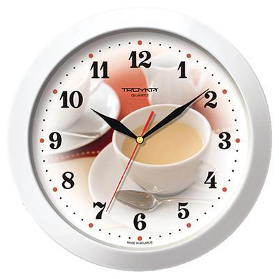 Часы настенные Troyka, цвет: белый. 1111018711110187Настенные кварцевые часы Troyka с изображением чашки кофе с молоком, изготовленные из пластика, прекрасно подойдут под интерьер вашего дома. Круглые часы имеют три стрелки: часовую, минутную и секундную, циферблат защищен прозрачным пластиком. Диаметр часов: 29 см. Часы работают от 1 батарейки типа АА напряжением 1,5 В. Внимание! Часы укомплектованы бесплатным тестовым элементом питания для обеспечения их работоспособности при предпродажной подготовке и демонстрации рабочих функций.