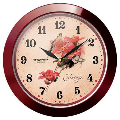 Часы настенные Troyka, цвет: коричневый. 1113115511131155Настенные кварцевые часы Troyka, изготовленные из пластика, прекрасно подойдут под интерьер вашего дома. Круглые часы имеют три стрелки: часовую, минутную и секундную, циферблат защищен прозрачным пластиком. Диаметр часов: 29 см. Часы работают от 1 батарейки типа АА напряжением 1,5 В. Внимание! Часы укомплектованы бесплатным тестовым элементом питания для обеспечения их работоспособности при предпродажной подготовке и демонстрации рабочих функций.