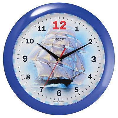 Часы настенные Troyka, цвет: синий. 1114012411140124Настенные кварцевые часы Troyka с изображением парусника, изготовленные из пластика, прекрасно подойдут под интерьер вашего дома. Круглые часы имеют три стрелки: часовую, минутную и секундную, циферблат защищен прозрачным пластиком. Диаметр часов: 29 см. Часы работают от 1 батарейки типа АА напряжением 1,5 В. Внимание! Часы укомплектованы бесплатным тестовым элементом питания для обеспечения их работоспособности при предпродажной подготовке и демонстрации рабочих функций.
