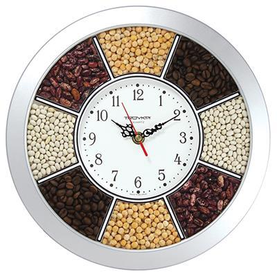 Часы настенные Troyka, цвет: серебристый. 1117014011170140Настенные кварцевые часы Troyka с вставкой из зерен кофе и бобовых, изготовленные из пластика, прекрасно подойдут под интерьер вашего дома. Круглые часы имеют три стрелки: часовую, минутную и секундную, циферблат защищен прозрачным стеклом Диаметр часов: 29,5 см. Часы работают от 1 батарейки типа АА напряжением 1,5 В. Внимание! Часы укомплектованы бесплатным тестовым элементом питания для обеспечения их работоспособности при предпродажной подготовке и демонстрации рабочих функций.