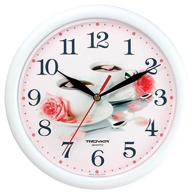 Часы настенные Troyka, цвет: белый. 2121025121210251Настенные кварцевые часы Troyka с изображением чашки и лепестков, изготовленные из пластика, прекрасно подойдут под интерьер вашего дома. Круглые часы имеют три стрелки: часовую, минутную и секундную, циферблат защищен прозрачным пластиком. Диаметр часов: 24,5 см. Часы работают от 1 батарейки типа АА напряжением 1,5 В. Внимание! Часы укомплектованы бесплатным тестовым элементом питания для обеспечения их работоспособности при предпродажной подготовке и демонстрации рабочих функций.