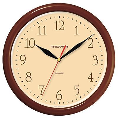 Часы настенные Troyka, цвет: коричневый. 2123428721234287Настенные кварцевые часы Troyka в классическом стиле, изготовленные из пластика, прекрасно подойдут под интерьер вашего дома. Круглые часы имеют три стрелки: часовую, минутную и секундную, циферблат защищен прозрачным пластиком. Диаметр часов: 24,5 см. Часы работают от 1 батарейки типа АА напряжением 1,5 В. Внимание! Часы укомплектованы бесплатным тестовым элементом питания для обеспечения их работоспособности при предпродажной подготовке и демонстрации рабочих функций.