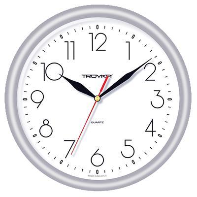 Часы настенные Troyka, цвет: серебристый. 2127021221270212Настенные кварцевые часы Troyka в классическом стиле, изготовленные из пластика, прекрасно подойдут под интерьер вашего дома. Круглые часы имеют три стрелки: часовую, минутную и секундную, циферблат защищен прозрачным пластиком. Диаметр часов: 24,5 см. Часы работают от 1 батарейки типа АА напряжением 1,5 В. Внимание! Часы укомплектованы бесплатным тестовым элементом питания для обеспечения их работоспособности при предпродажной подготовке и демонстрации рабочих функций.
