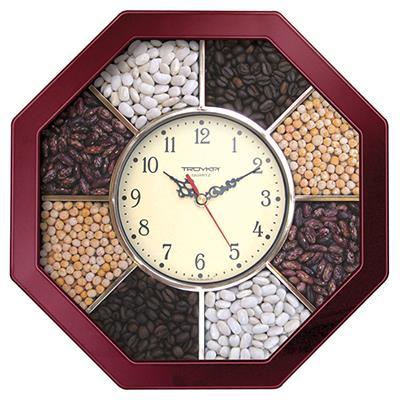 Часы настенные Troyka, цвет: коричневый. 4143132141431321Настенные кварцевые часы Troyka, изготовленные из пластика, прекрасно подойдут под интерьер вашего дома. Восьмиугольные часы имеют три стрелки: часовую, минутную и секундную, циферблат защищен прозрачным пластиком. Циферблат обрамлен рамкой с ячейками, наполненными фасолью, горохом и кофейными зернами. Размер часов: 29 см х 29 см х 3,5 см. Часы работают от 1 батарейки типа АА напряжением 1,5 В. Внимание! Часы укомплектованы бесплатным тестовым элементом питания для обеспечения их работоспособности при предпродажной подготовке и демонстрации рабочих функций.