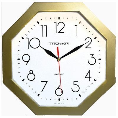 Часы настенные Troyka, цвет: золотой. 4147141941471419Настенные кварцевые часы Troyka, выполненные в классическом стиле, изготовленные из пластика, прекрасно подойдут под интерьер вашего дома. Многоугольные часы имеют три стрелки: часовую, минутную и секундную, циферблат защищен прозрачным пластиком. Размер часов: 29 см х 29 см х 3,5 см. Часы работают от 1 батарейки типа АА напряжением 1,5 В. Внимание! Часы укомплектованы бесплатным тестовым элементом питания для обеспечения их работоспособности при предпродажной подготовке и демонстрации рабочих функций.