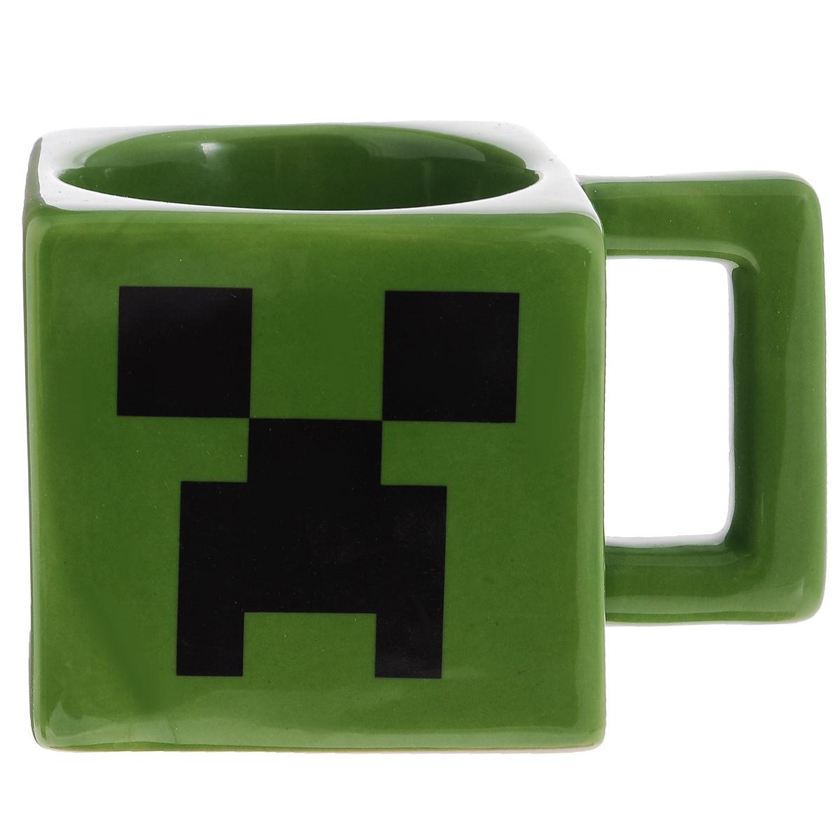 Кружка Minecraft Creeper Face Mug, цвет: зеленый, черный, 236 мл23672Квадратная кружка Minecraft Creeper Face Mug - зеленого цвета с изображением лица Крипера из Minecraft! Отличный подарок фанату! Утро начинается с чашки чая или кофе, утро начинается с квадратной кружки по Майнкрафту! Если ваш ребенок увлекается игрой Майнкрафт, такой подарок ему очень понравится!