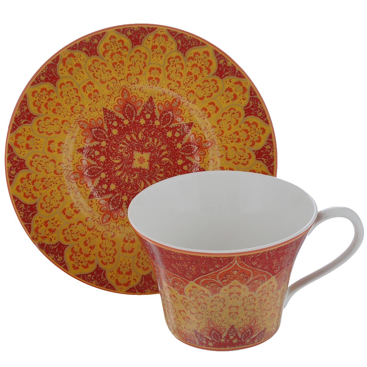 Чайная пара Utana Кашан, цвет: оранжевый, красный, 2 предметаUTKR94201/2Чайная пара Utana Кашан состоит из чашки и блюдца, выполненных из высококачественной керамики. Красочность оформления придется по вкусу и ценителям классики, и тем, кто предпочитает утонченность и изысканность. Оригинальный орнамент придает набору особый шарм, который понравится каждому. Предметы набора можно использовать в микроволновой печи и мыть в посудомоечной машине. Объем чашки: 250 мл. Диаметр чашки (по верхнему краю): 10 см. Высота чашки: 7,5 см. Диаметр блюдца: 16 см.