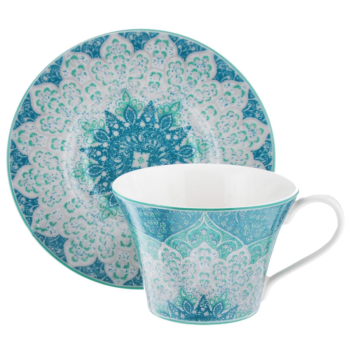 Чайная пара Utana Кашан, цвет: бирюзовый, 2 предметаUTKB94201/2Чайная пара Utana Кашан состоит из чашки и блюдца, выполненных из высококачественной керамики. Красочность оформления придется по вкусу и ценителям классики, и тем, кто предпочитает утонченность и изысканность. Оригинальный орнамент придает набору особый шарм, который понравится каждому. Предметы набора можно использовать в микроволновой печи и мыть в посудомоечной машине. Объем чашки: 250 мл. Диаметр чашки (по верхнему краю): 10 см. Высота чашки: 7,5 см. Диаметр блюдца: 16 см.