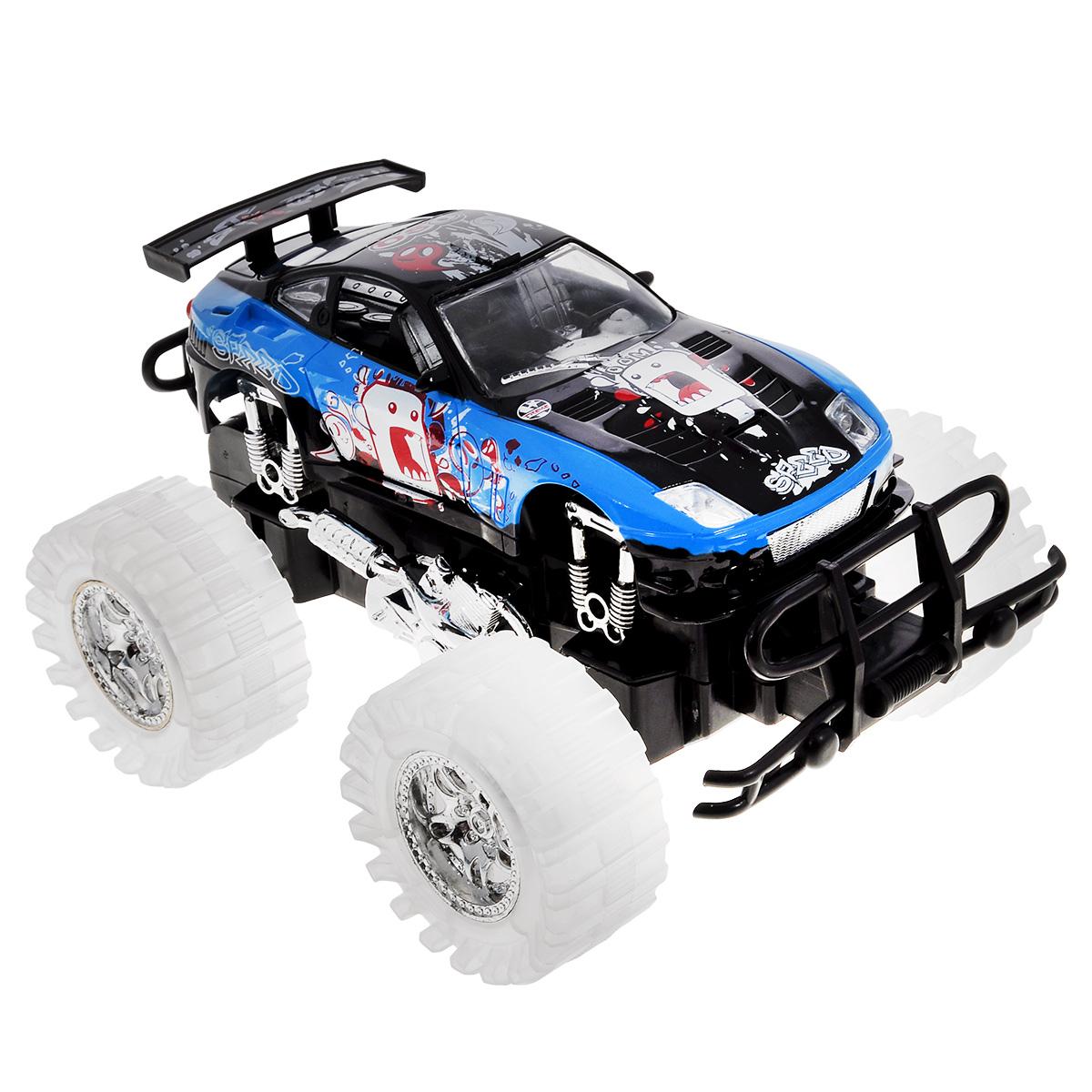 Машинка Пламенный мотор, большие колеса, цвет: черный, голубой87481_черный/голубойМашинка Пламенный мотор с инерционным механизмом, звуковыми и световыми эффектами непременно понравится любому мальчишке. Благодаря инерционному механизму игрушка может двигаться самостоятельно, стоит только откатить машинку назад, а затем отпустить, и она поедет вперед. Этот четырехколесный гигант, известный также как бигфут или монстр-трак, выполнен из высококачественного пластика - ему не страшны столкновения и препятствия! Игрушка работает от трех батареек LR44 1,5V (в комплекте).