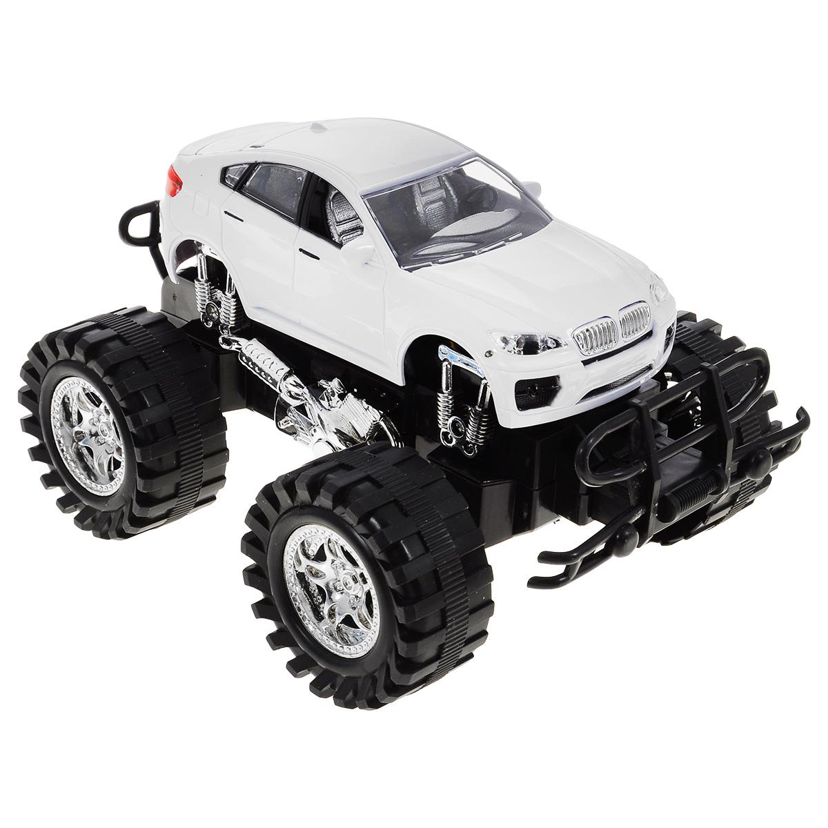 Машинка Пламенный мотор, большие колеса, цвет: белый87474_белыйМашинка Пламенный мотор с инерционным механизмом, звуковыми и световыми эффектами непременно понравится любому мальчишке. Благодаря инерционному механизму игрушка может двигаться самостоятельно, стоит только откатить машинку назад, а затем отпустить, и она поедет вперед. Этот четырехколесный гигант, известный также как бигфут или монстр-трак, выполнен из высококачественного пластика - ему не страшны столкновения и препятствия! Игрушка работает от трех батареек LR44 1,5V (в комплекте).