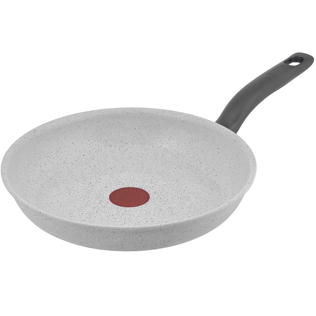 Сковорода Tefal Meteor, с керамическим покрытием, цвет: белый. Диаметр 28 см2100086788Сковорода Tefal Meteor изготовлена из алюминия с высококачественным керамическим минеральным покрытием. Сверхтвердая поверхность устойчива к появлению царапин и отличается особой прочностью, поэтому можно использовать металлические лопатки. На посуде с таким покрытием пищу можно готовить с минимальным добавлением подсолнечного масла, пища не пригорает и не прилипает к стенкам. После приготовления изделие очень легко моется. Кроме того, керамическое покрытие абсолютно безопасно для здоровья и экологично, так как не содержит кадмия, свинца и вредной примеси PFOA. Изделие подлежит переработке. Вся посуда Tefal оснащена уникальным индикатором Thermo-Spot. Когда надпись Thermo-Spot исчезнет, и диск станет равномерно красным, значит, сковорода нагрелась до оптимальной температуры, и можно начинать готовить. Такой индикатор поможет защитить посуду от перегрева, а значит, антипригарное покрытие прослужит вам дольше. Ручка эргономичной формы изготовлена из бакелита серого цвета....