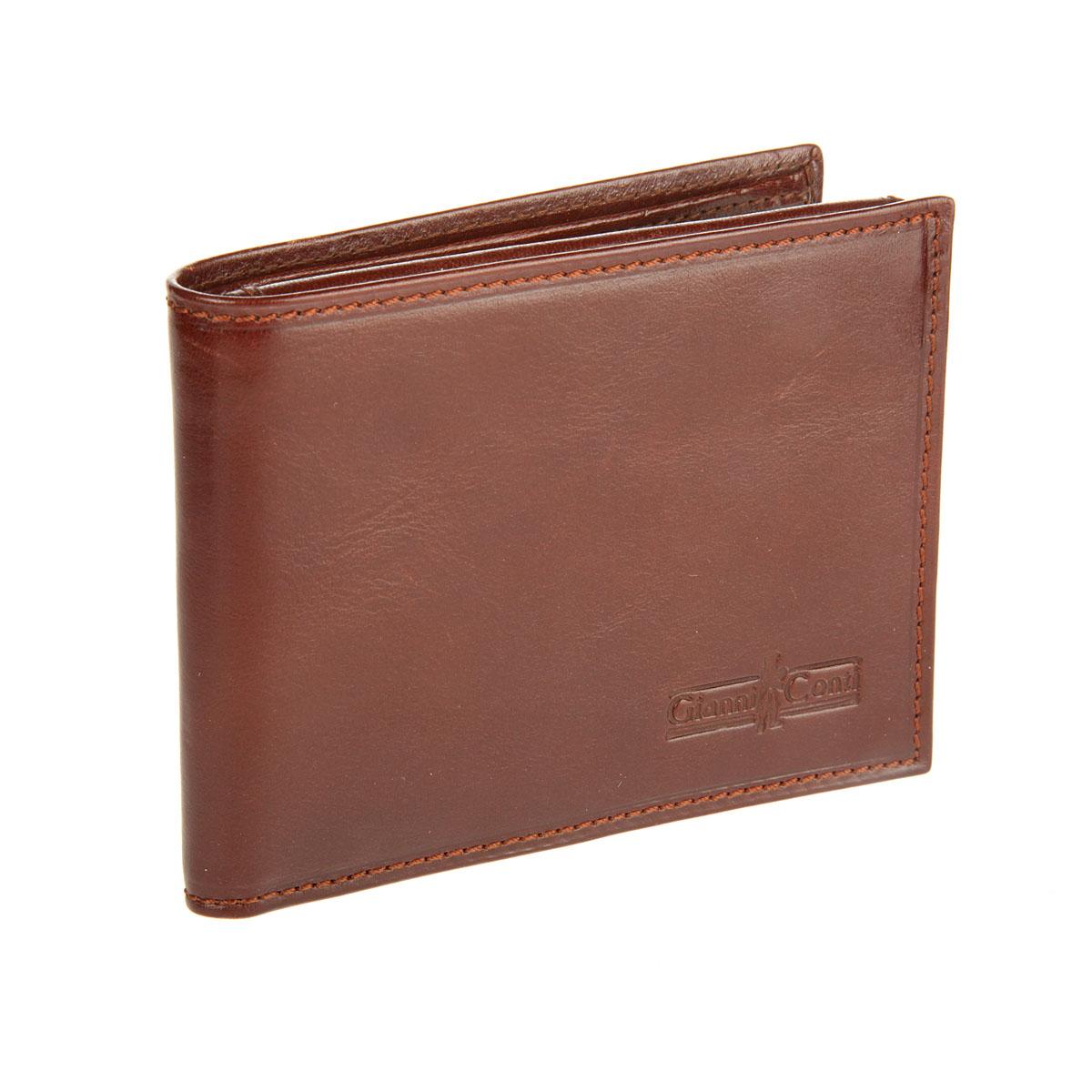 Портмоне мужское Gianni Conti, цвет: коричневый. 907022907022 brownСтильное мужское портмоне Gianni Conti выполнено из натуральной кожи. Лицевая сторона оформлена тиснением в виде названия бренда производителя. Изделие раскладывается пополам. Внутри имеется два отделения для купюр, четыре потайных кармана, карман для мелочи на кнопке, три кармашка для визиток и пластиковых карт, два сетчатых кармана и карман для документов. Портмоне упаковано в фирменную картонную коробку. Оригинальное портмоне подчеркнет вашу индивидуальность и изысканный вкус, а также станет замечательным подарком человеку, ценящему качественные и практичные вещи.