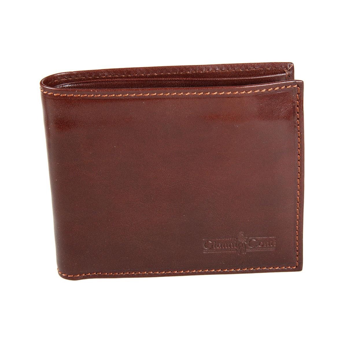Портмоне мужское Gianni Conti, цвет: коричневый. 907023907023 brownСтильное мужское портмоне Gianni Conti выполнено из натуральной кожи. Лицевая сторона оформлена тиснением в виде названия бренда производителя. Изделие раскладывается пополам. Внутри имеется два отделения для купюр, четыре потайных кармана, карман для мелочи на кнопке, семь кармашков для визиток и пластиковых карт и сетчатый карман. Портмоне упаковано в фирменную картонную коробку. Оригинальное портмоне подчеркнет вашу индивидуальность и изысканный вкус, а также станет замечательным подарком человеку, ценящему качественные и практичные вещи.