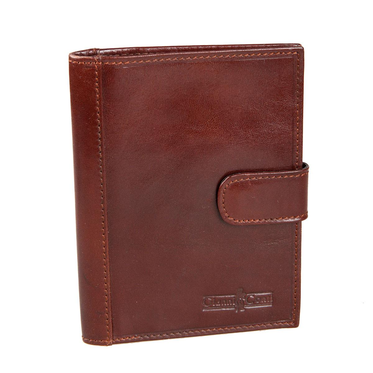 Обложка для паспорта мужская Gianni Conti, цвет: коричневый. 907035907035 brownСтильная обложка для паспорта Gianni Conti выполнена из натуральной кожи глянцевой текстурой. Обложка оформлена декоративной строчкой и выбитым клеймом с изображением логотипа названия бренда. Изделие раскладывается пополам и закрывается на хлястик с кнопкой, внутри расположены шесть карманов для визитных или пластиковых карт, два накладных кармана для документов и карман-стенка для паспорта. Элегантная обложка Gianni Conti не только поможет сохранить внешний вид ваших документов и защитит их от повреждений, но и станет стильным аксессуаром, идеально подходящим вашему образу.
