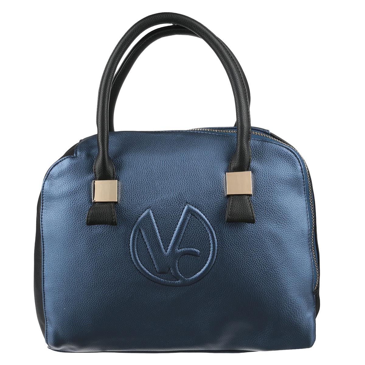 Сумка женская Vitacci, цвет: синий. V090V090Стильная женская сумка Vitacci изготовлена из высококачественной искусственной кожи. Застежка-молния расположена по диагонали, что придает изделию неповторимую оригинальность. Удобные ручки прочно крепятся к корпусу сумки при помощи металлической фурнитуры. Внутреннее отделение содержит два кармана на застежках-молниях, которые образуют открытый карман, и два накладных кармашка для мелочей и мобильного телефона. Тыльная сторона сумки дополнена врезным карманом на застежке-молнии. Дно защищено от повреждений металлическими ножками. Фурнитура золотистого цвета. Сумка - это стильный аксессуар, который подчеркнет вашу изысканность и индивидуальность и сделает ваш образ завершенным. Изделие упаковано в фирменный чехол.