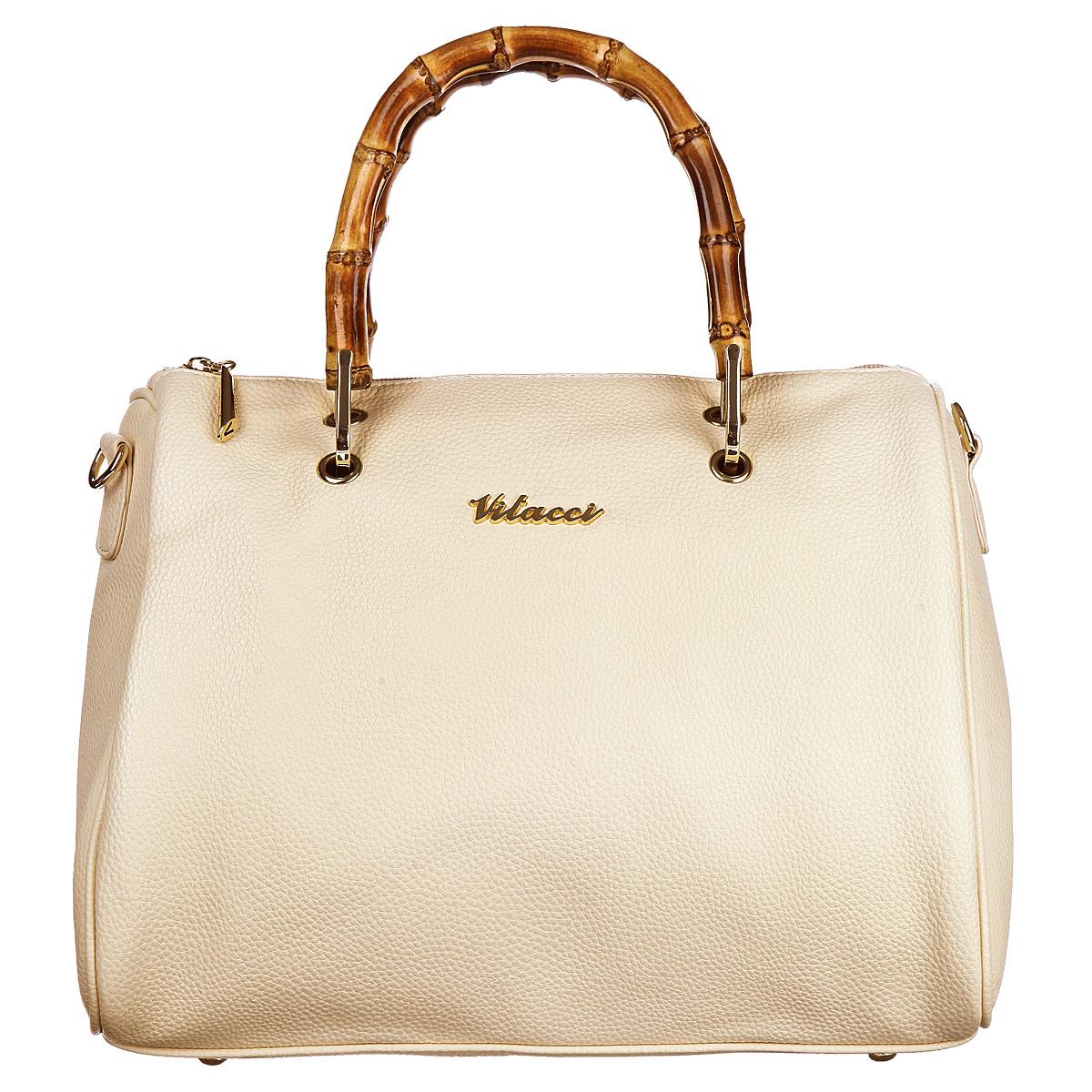 Сумка женская Vitacci, цвет: бежевый. V08V08Оригинальная женская сумка Vitacci изготовлена из высококачественной искусственной кожи. Ручки, выполненные из дерева, прочно крепятся к корпусу сумки. Изделие закрывается на застежку-молнию. Внутреннее отделение содержит два кармана на застежках-молниях, которые образуют открытый карман, и два накладных для мелочей и мобильного телефона. Тыльная сторона сумки дополнена врезным карманом на застежке-молнии. Фурнитура золотистого цвета. Дно защищено от повреждений металлическими ножками. В комплект входит съемный плечевой ремень регулируемой длины. Сумка - это стильный аксессуар, который подчеркнет вашу изысканность и индивидуальность и сделает ваш образ завершенным. Изделие упаковано в фирменный чехол.