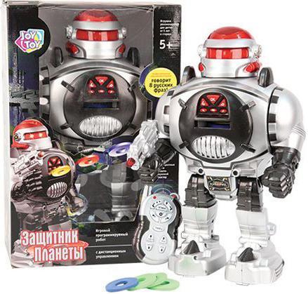 Joy Toy Робот на радиоуправлении Защитник планеты цвет серыйБ29895/115966/А224-Н08032С какими игрушками любят играть все без исключения мальчишки? Правильно, с роботами! Представленная радиоуправляемая модель работает с помощью батареек, выполнена из высококачественных полимерных материалов и предназначена для детей от пяти лет. Робот имеет звуковые эффекты, произносит восемь фраз и стреляет мягкими дисками.