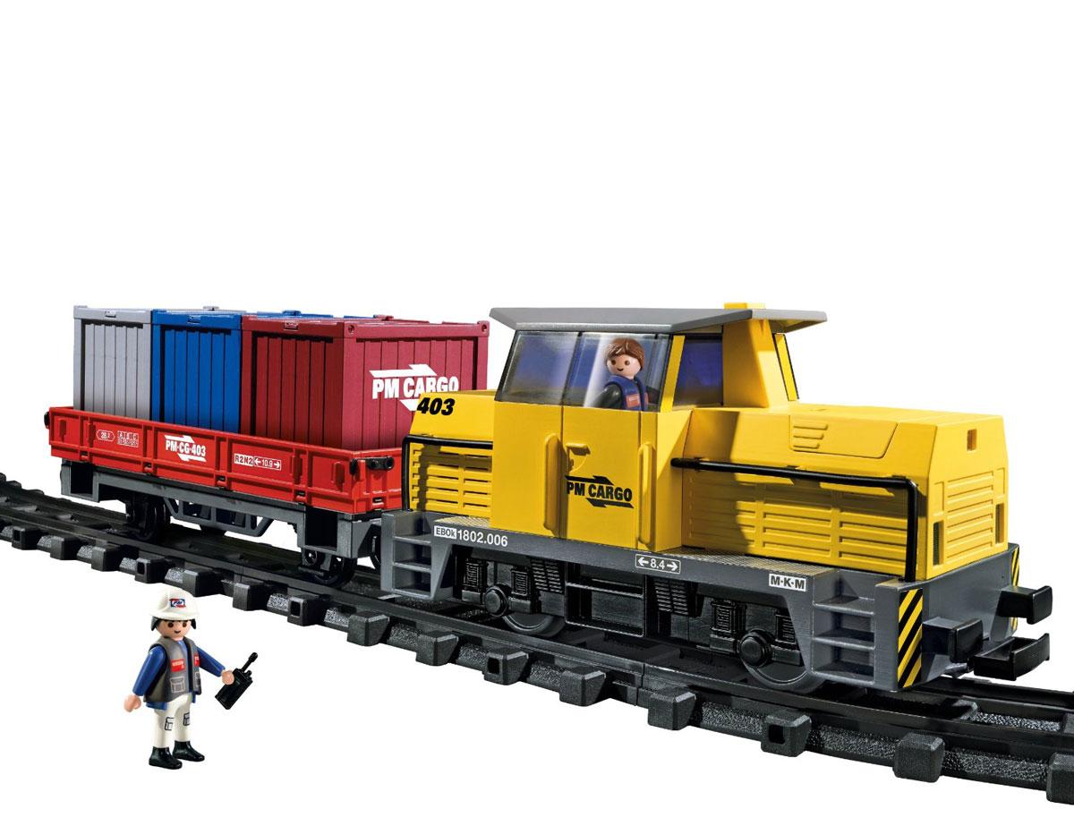 Playmobil Игровой набор Грузовой поезд с контейнерами5258pmИгровой набор Playmobil Грузовой поезд с контейнерами обязательно понравится вашему ребенку. Он выполнен из безопасного пластика и включает две фигурки в виде машиниста и рабочего, элементы для сборки железной дороги, электровоз, пульт управления, платформу для погрузки, а также контейнеры различной величины и другие аксессуары для игры. У фигурок подвижные части тела; в руках они могут удерживать предметы. Управляемый пультом, электровоз движется по железной дороге, а его фары светятся. Ваш ребенок с удовольствием будет играть с набором, придумывая захватывающие истории. Рекомендуемый возраст: от 4 до 10 лет. Для работы электровоза необходимо докупить 6 батареек напряжением 1,5V типа АА (не входят в комплект). Для работы пульта управления необходимо докупить 1 батарейку напряжением 9V типа Крона (не входит в комплект).