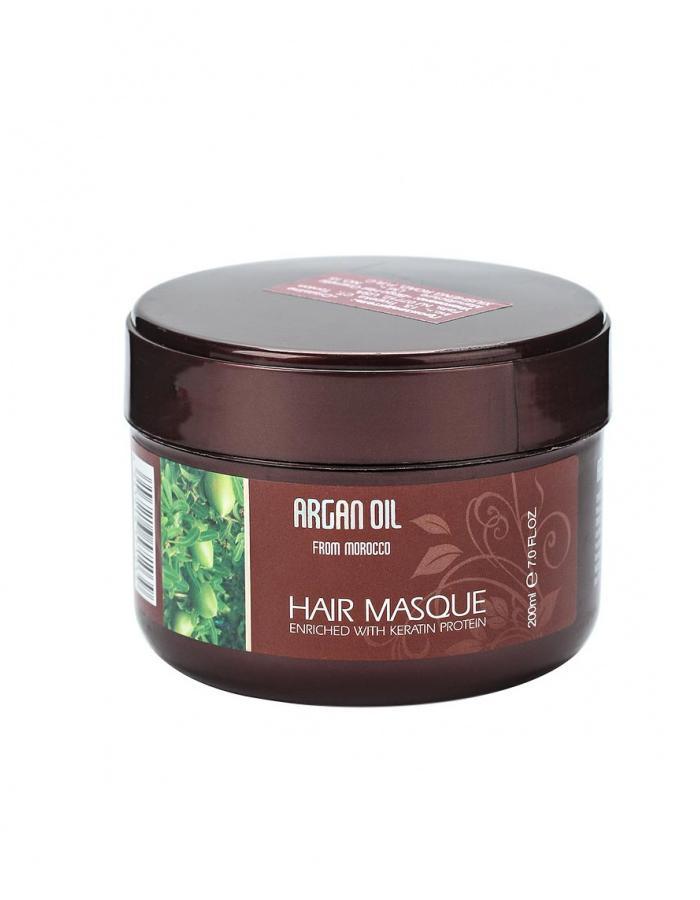 Morocco Argan Oil Восстанавливающая маска с маслом арганы и кератином, 200 мл6590121Профессиональная маска для ухода за волосами с драгоценным маслом арганы и протеинами кератина обеспечивает волосам силу и восстановление по всей длине, улучшает их качество и внешний вид, делает их блестящими и густыми. Активные ингредиенты и их эффект: Протеины и аминокислоты кератина проникают вглубь волоса, буквально соединяя разрозненные чешуйки волоса, быстро и заметно восстанавливая его. Благодаря кератину волосы быстро и заметно улучшаются, становятся менее хрупкими и ломкими. Масло арганы, являясь ценнейшим компонентом растительного происхождения, идеально подходит для ухода за волосами. Масло обеспечивает надежную защиту, дарит волосам блеск, укрепляет и восстанавливает их по всей длине. Экстракт алоэ увлажняет и препятствует потере влаги, одновременно насыщая волосы необходимыми питательными веществами, делая их более сильными и крепкими. Экстракт корня алтея питает корни,...
