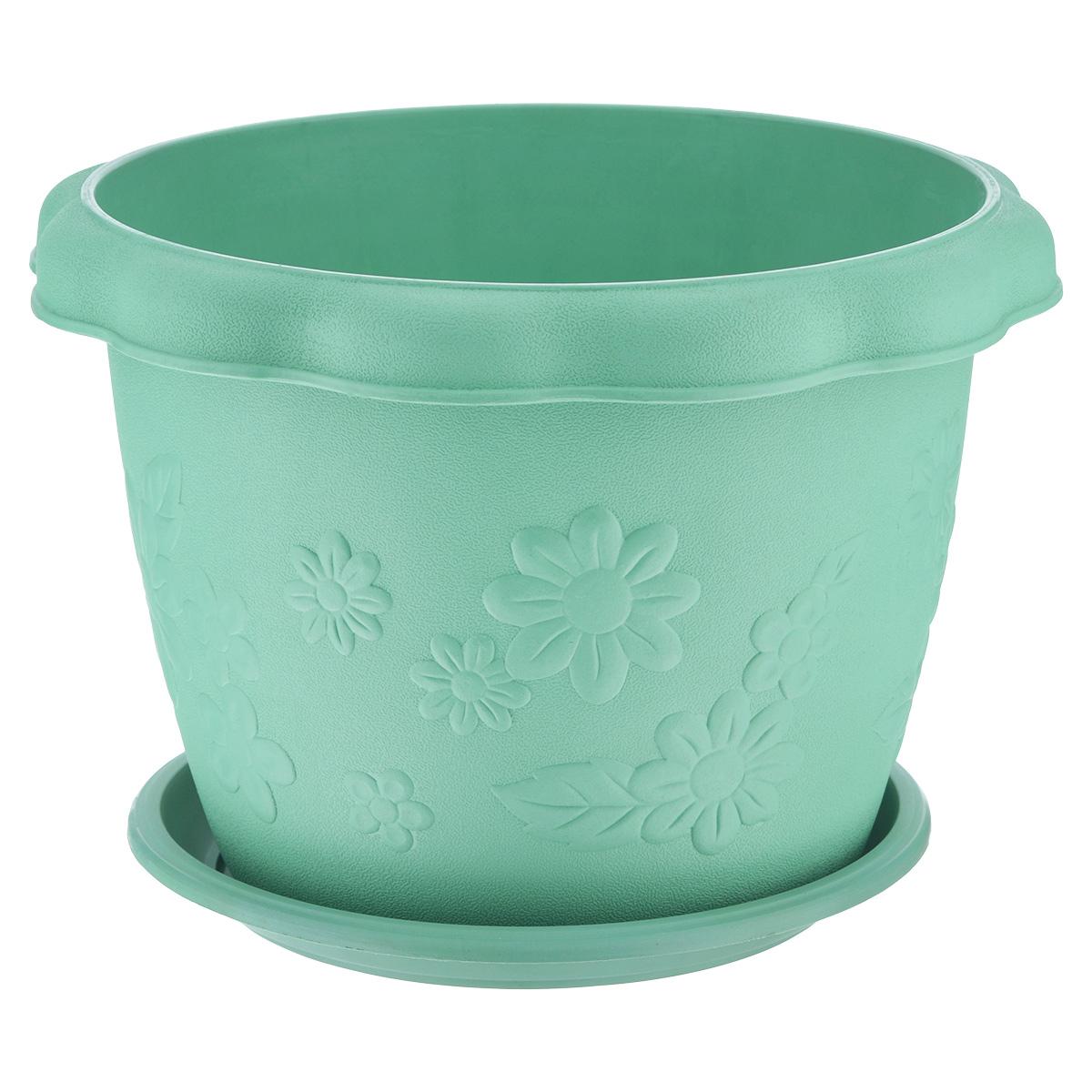 Кашпо Ludu Цветы, с поддоном, цвет: зеленый, диаметр 26 смKD3904GКашпо Ludu Цветы изготовлено из высококачественного пластика. Специальный поддон предназначен для стока воды. Изделие прекрасно подходит для выращивания растений и цветов в домашних условиях. Лаконичный дизайн впишется в интерьер любого помещения. Диаметр поддона: 21,5 см.