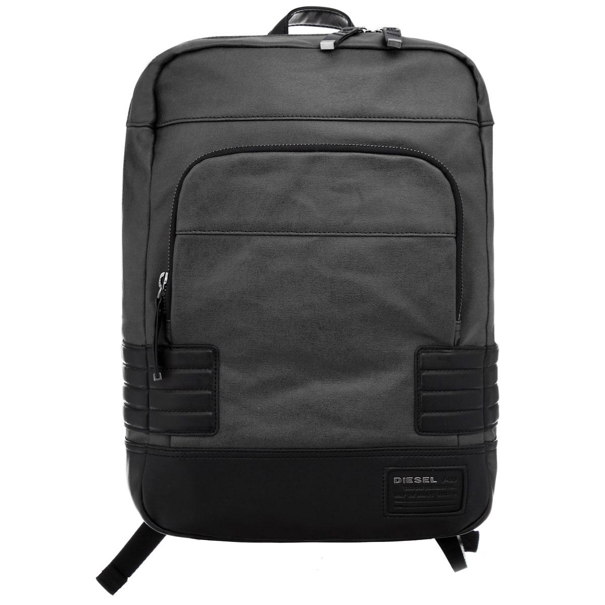 Рюкзак мужской Diesel, цвет: черный, серый. X02676-PS888/H1669X02676-PS888/H1669Стильный мужской рюкзак Diesel выполнен из полиуретана и текстиля, оформлен логотипом производителя. Рюкзак оснащен одним основным отделением, закрывающимся на застежку-молнию. Внутри основного отделения размещен мягкий карман для планшета на липучке и встроенный органайзер, включающий в себя вшитый карман на молнии, три накладных кармана, кармашек для ручки и накладной карман на липучке для телефона. Снаружи, лицевой стороне изделия размещен накладной карман на молнии. Рюкзак оснащен практичными широкими лямками, длина которых регулируется, а также петлей для подвешивания изделия. Рюкзак Diesel - практичное и стильное приобретение на каждый день.