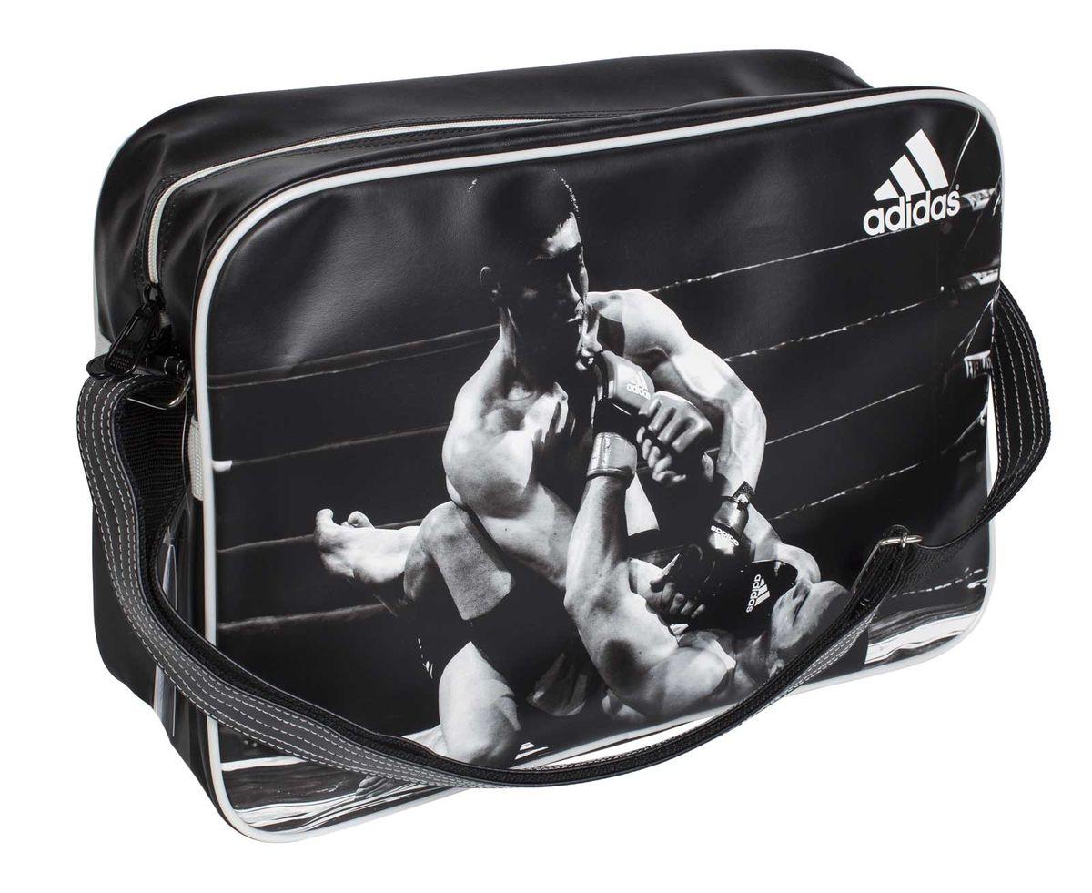 Сумка спортивная Adidas Sports Bag MMA, цвет: черный, белый. Размер LadiACC111CS-M-LСпортивная сумка Adidas Sports Bag MMA изготовлена из искусственной кожи. Лицевая сторона сумки оформлена оригинальным принтом. Она предназначена для переноски и хранения спортивного инвентаря и других нужных для занятия спортом предметов. Сумка состоит из 1 большого отделения. Имеет удобный плечевой ремень.