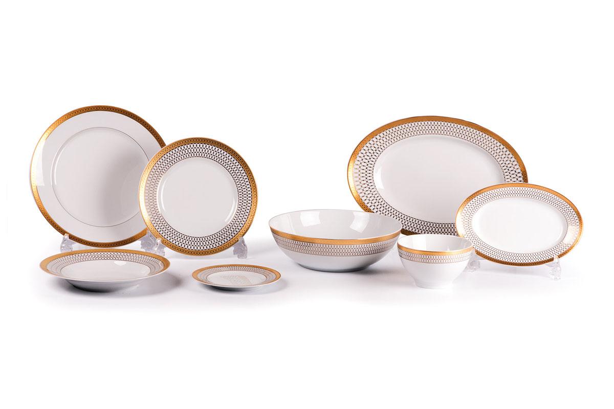 Сервиз столовый, 41пр, цвет: белый с золотом539219 1488Глубокая тарелка 22 см 6 штук , тарелка 27 см 12 штук , десертная тарелка 21 см 6 штук , тарелка 16 см 6 штук, солонка, перечница, Блюдо овальное 24 см, Блюдо овальное 28 см , салатник 13 см 6 штук, салатник 25 см, соусник 230мл. Элегантная посуда класса люкс теперь на вашем столе каждый день. Сделанные из высококачественного материала с использованием новейших технологий, предметы сервировки Tunisie Porcelaine невероятно прочны и прекрасно подходят для повседневного использования. Материал: фарфор: цвет: белый с золотом Серия: TANIT