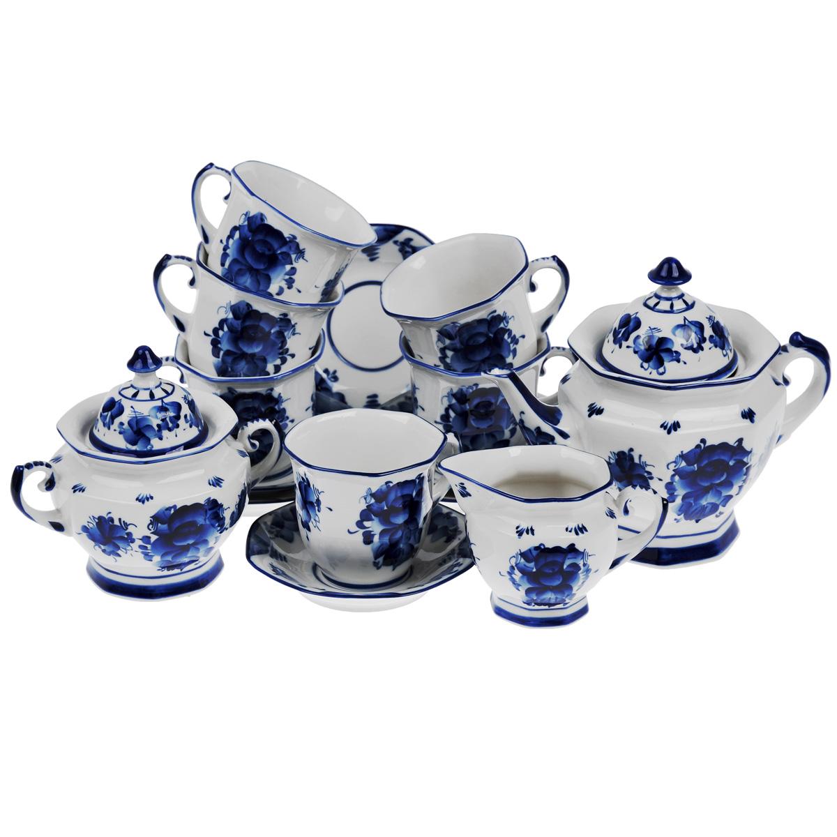 Сервиз чайный Граненый, цвет: белый, синий, 15 предметов993004412Сервиз чайный Граненый выполнен из керамики и состоит из шести чашек, шести блюдец, чайника, молочника и сахарницы. Предметы набора оформлены росписью в технике гжель. Изящный дизайн придется по вкусу и ценителям классики, и тем, кто предпочитает утонченность и изысканность. Он настроит на позитивный лад и подарит хорошее настроение с самого утра. Оригинальный дизайн сервиза позволит украсить любую кухню, внеся разнообразие как в строгий классический стиль, так и в современный кухонный интерьер. Количество чашек: 6 шт. Диаметр чашек по верхнему краю: 10 см. Высота чашек: 9 см. Объем чашек: 300 мл. Количество блюдец: 6 шт. Диаметр блюдец: 14,5 см. Высота блюдец: 3 см. Высота сахарницы (с учетом крышки): 17,5 см. Диаметр сахарницы по верхнему краю: 11 см. Высота чайника (с учетом крышки): 21 см. Диаметр чайника по верхнему краю: 12,5 см. Объем чайника: 900 мл. Высота молочника (с учетом...