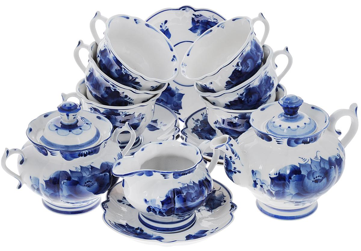Сервиз чайный Орхидея, 15 предметов993051012Чайный сервиз Орхидея состоит из 6 чашек, 6 блюдец, молочника, заварочного чайника и сахарницы. Предметы набора изготовлены из высококачественной керамики и оформлены гжельской росписью. Изящный дизайн придется по вкусу и ценителям классики, и тем, кто предпочитает утонченность и изысканность. Он настроит на праздничный лад и подарит хорошее настроение с самого утра. Чайный набор - идеальный и необходимый подарок для вашего дома и для ваших друзей в праздники, юбилеи и торжества! Он также станет отличным корпоративным подарком и украшением любой кухни. Уважаемые клиенты! Обращаем ваше внимание, что роспись на изделиях сделана вручную. Рисунок может немного отличаться от изображения на фотографии. Объем чашки: 200 мл. Диаметр чашки (по верхнему краю): 10 см. Высота чашки: 7,5 см. Диаметр блюдца: 16 см. Объем чайника: 650 мл. Диаметр чайника (по верхнему краю): 5,5 см. Высота чайника (без...