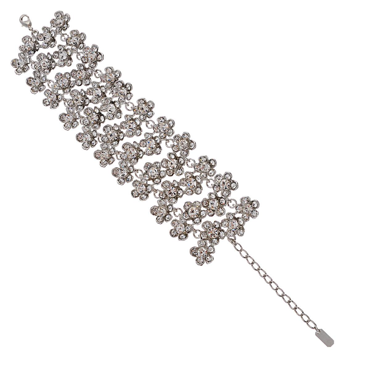 Браслет Avgad, цвет: серебристый. BR77KL115BR77KL115Изысканный браслет Avgad изготовлен из ювелирного сплава и оформлен декоративными элементами в виде цветов, дополненных в центре австрийскими кристаллами. Застегивается изделие на замок-карабин. Длина регулируется за счет цепочки. Это оригинальное украшение внесет изюминку в ваш модный образ и позволит выделиться среди окружающих.
