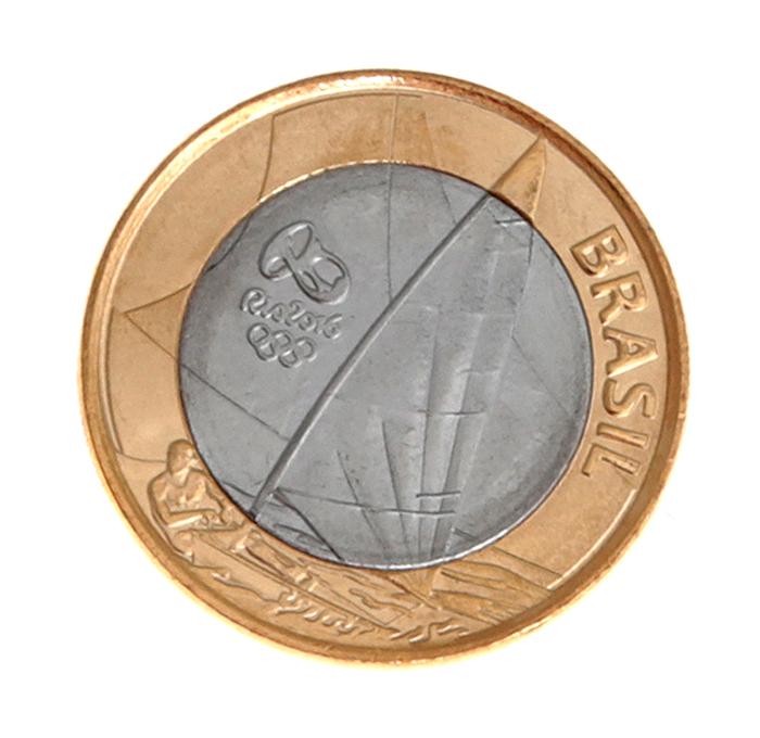 Монета номиналом 1 реал XXXI летние Олимпийские Игры, Рио-де-Жанейро 2016. Виндсерфинг. Бразилия, 2015 год725Состояние: UNC. Диаметр: 27 мм. Вес: 7 гр. Материал: Нержавеющая сталь / сталь, покрытая бронзой.