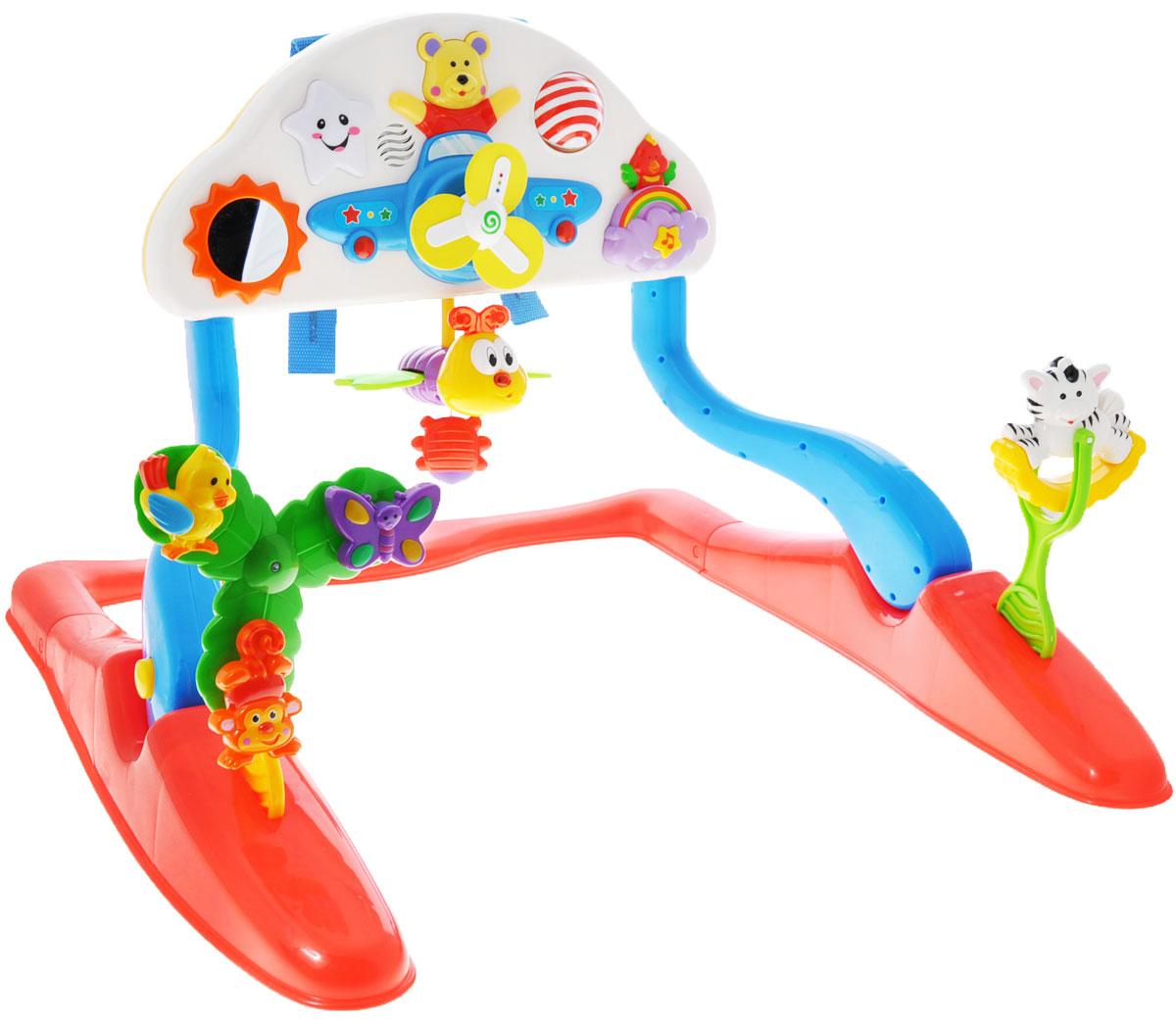 Kiddieland Развивающий гимнастический центр для малыша Flyng funKID 041913Развивающий гимнастический центр для малыша Kiddieland Flyng fun - это яркая игровая стойка на устойчивом основании, которая развлечет малыша мигающими огоньками, забавными мелодиями и приятными звуками. Малыш всегда найдет чем себя занять с таким центром, ведь здесь есть разнообразные кнопки и игрушки, подвески и даже зеркальце. Стойка может устанавливаться в два положения, для игры лежа и для игры сидя. С помощью специальных ремней ее можно закрепить на детской кроватке. На стойке расположены различные кнопочки, нажимая которые, малыш будет слышать забавные мелодии. В центре основной панели расположен самолет с подвижными светящимися лопастями. На основании игрового центра расположены игрушки с крутящимися элементами. Развивающий центр дополнен игрушкой-пчелкой с инерционным механизмом. Игрушка развивает мелкую моторику, мышление, зрительное и звуковое восприятие, повышает двигательную активность малышей. Рекомендуемый возраст: от 18 месяцев. Питание: 3 батарейки типа...