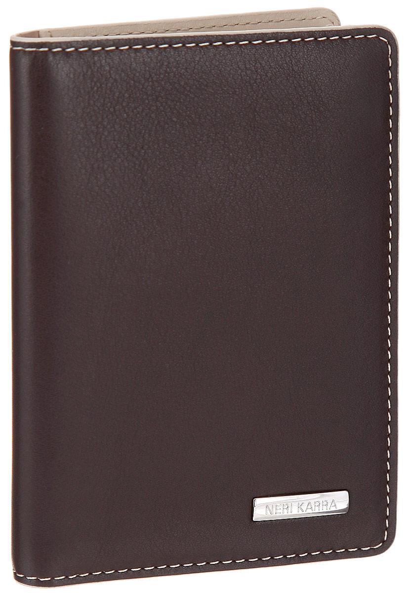 Обложка для автодокументов Neri Karra, цвет: коричневый, бежевый. 0132 3-01.49/330132 3-01.49/33Стильная обложка для автодокументов Neri Karra выполнена из натуральной высококачественной кожи и декорирована прострочкой по контуру. Лицевая сторона обложки оформлена металлической пластиной с названием бренда. Модель содержит съемный блок из шести прозрачных файлов из мягкого пластика и два вертикальных кармана. В обложке помимо основных документов на автомобиль можно разместить 7 пластиковых карт, для этого предусмотрено 6 кармашков и сетчатое окошко. Изделие упаковано в стильную фирменную коробку. Обложка не только поможет сохранить внешний вид ваших документов и защитить их от повреждений, но и станет стильным аксессуаром, который подчеркнет ваш неповторимый стиль.
