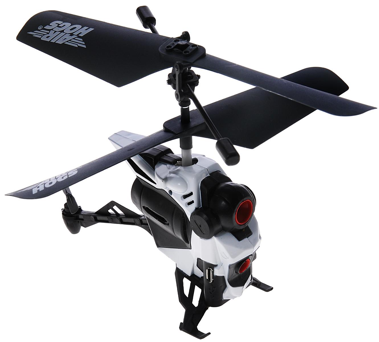 Air Hogs Вертолет на радиоуправлении Altitude Video Drone44545Вертолет на инфракрасном управлении AirHogs Altitude Video Drone с камерой станет отличным подарком любому мальчишке! Управление вертолетом и камерой осуществляется с помощью 3-канального инфракрасного пульта управления. Встроенный гироскоп обеспечит ровность полета, а система стабилизации съемки сделает видео плавным и приятным для просмотра. Камера с разрешением 0.3 Мп записывает видео и фото на встроенную память, откуда отснятый материал можно скопировать на компьютер через USB (кабель в комплекте). Зарядка встроенного аккумулятора вертолета осуществляется от пульта управления. Время зарядки 40 минут. Время непрерывной работы игрушки 5 минут. Для работы пульта управления необходимы 3 батарейки напряжением 1,5 V типа ААА (не входят в комплект).