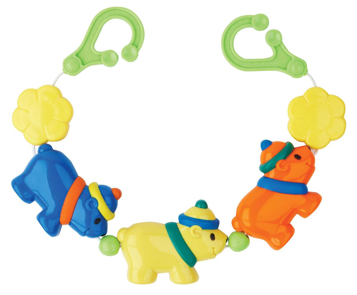 Курносики Погремушка-подвеска на коляску Веселые щенки21031Погремушка-подвеска в коляску Веселые щенки не оставит вашего малыша равнодушным и не позволит ему скучать! Подвеска представляет собой трех симпатичных щенков, нанизанных на резинку. Пря тряске горошинки внутри игрушек весело перекатываются и гремят, развлекая малыша. На концах резинки расположены пластиковые колечки, при помощи которых подвеску удобно закрепить на коляске, детском кресле или кроватке ребенка. Малыш с удовольствием будет изучать забавных разноцветных животных. Погремушка-подвеска поможет вашему ребенку развить зрительное и слуховое восприятия, тактильные ощущения, мелкую моторику рук и координацию движений.