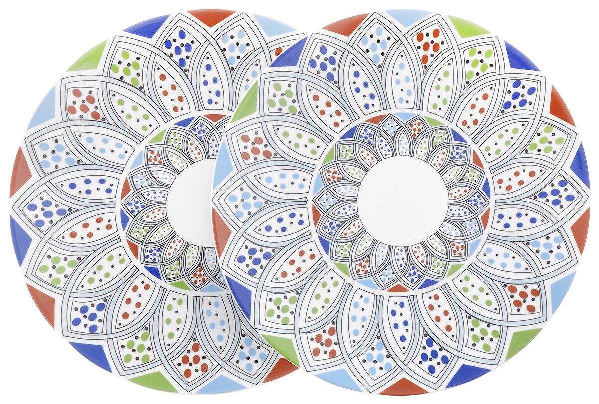 Набор тарелок La Rose Des Sables Monalisa, диаметр 27 см, 2 шт7 201 272 094Набор La Rose Des Sables Monalisa, выполненный из высококачественного фарфора, состоит из двух тарелок. Изделия декорированы оригинальным восточным узором и прекрасно подойдут для красивой сервировки стола. Эстетичность, функциональность и изящный дизайн сделают набор достойным дополнением к вашему кухонному инвентарю. Набор тарелок La Rose Des Sables Monalisa украсит ваш стол и станет отличным подарком к любому празднику. Диаметр тарелки: 27 см. Высота тарелки: 3 см.
