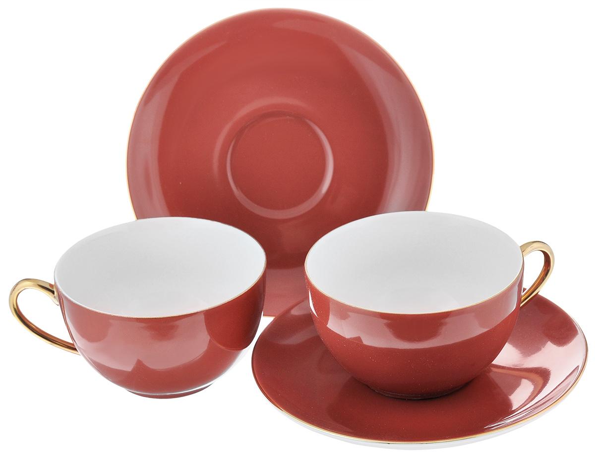 Набор чайный La Rose Des Sables Monalisa, цвет: красный, золотистый, 4 предмета6 195 003 125Чайный набор La Rose Des Sables Monalisa состоит из двух чашек и двух блюдец. Предметы набора изготовлены из высококачественного фарфора. Изящный дизайн придется по вкусу и ценителям классики, и тем, кто предпочитает утонченность и изысканность. Он настроит на праздничный лад и подарит хорошее настроение с самого утра. Чайный набор - идеальный и необходимый подарок для вашего дома и для ваших друзей в праздники, юбилеи и торжества! Он также станет отличным корпоративным подарком и украшением любой кухни. Не рекомендуется использовать в микроволновой печи и мыть в посудомоечной машине. Объем чашки: 210 мл. Диаметр чашки (по верхнему краю): 9,5 см. Высота чашки: 5 см. Диаметр блюдца: 15 см.