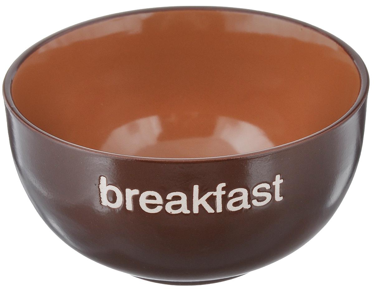 Салатница Wing Star Breakfast, цвет: темно-коричневый, диаметр 14 смLJ08040-MA9Салатница Wing Star Breakfast изготовлена из высококачественной керамики, а внешняя стенка украшена надписью Breakfast. Wing Star - качественная керамическая посуда из обожженной, глазурованной снаружи и изнутри глины с оригинальными рисунками. При изготовлении данной посуды широко используется рельефный способ нанесения декора, когда рельефная поверхность подготавливается в процессе формовки и изделие обрабатывается с уже готовым декором. Благодаря этому достигается эффект неровного на ощупь рисунка, как бы утопленного внутрь глазури и являющегося его естественным элементом. Яркая салатница станет украшением вашего стола и прекрасно подойдет для использования, как дома, так и на даче или пикниках. Можно использовать в микроволновой печи и посудомоечной машине. Диаметр салатницы по верхнему краю: 14 см. Высота стенки: 7 см.