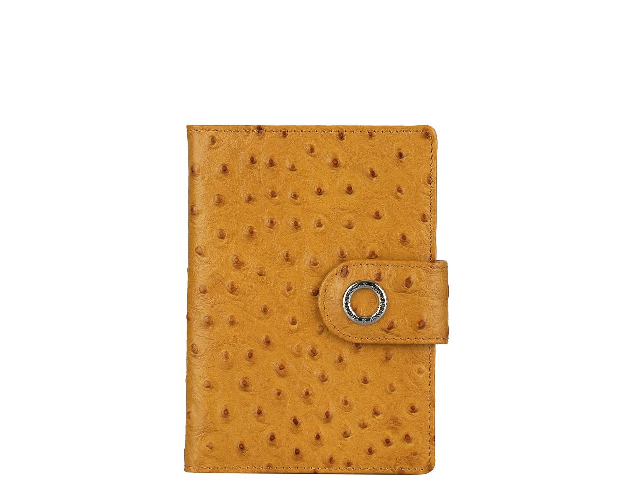 Обложка для паспорта женская Leo Ventoni, цвет: горчичный. L330414L330414-tanСтильная обложка для паспорта Leo Ventoni выполнена из натуральной кожи с декоративным тиснением под кожу страуса, дополнена металлической фурнитурой с символикой бренда. Изделие раскладывается пополам и закрывается хлястиком на кнопку. Внутри размещены два накладных кармана для паспорта и четыре кармана для кредитных карт. Изделие поставляется в фирменной упаковке. Оригинальная обложка для документов Leo Ventoni станет отличным подарком для человека, ценящего качественные и практичные вещи.
