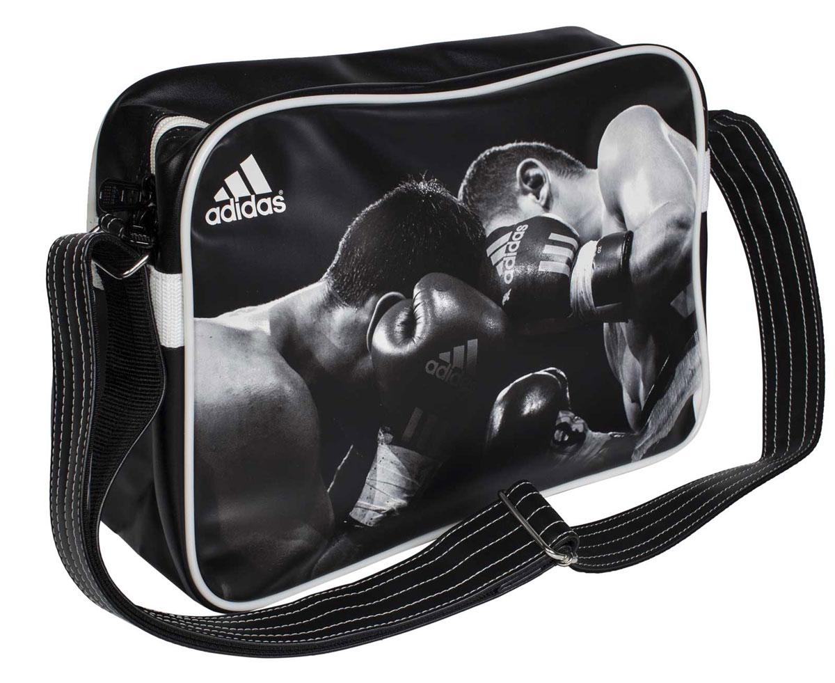 Сумка спортивная Adidas Sports Bag Boxing, цвет: черный, белый. Размер SadiACC111CS-B-SСпортивная сумка Adidas Sports Bag Boxing изготовлена из искусственной кожи. Лицевая сторона сумки оформлена оригинальным принтом. Она предназначена для переноски и хранения спортивного инвентаря и других нужных для занятия спортом предметов. Сумка состоит из 1 большого отделения. Имеет удобный плечевой ремень.