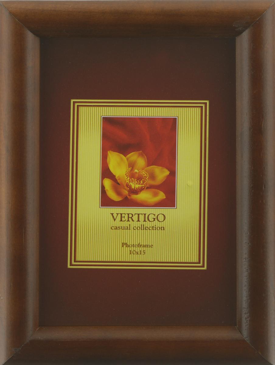 Фоторамка Vertigo Toscana, цвет: темно-коричневый, 10 х 15 см12194 WF-022/194Фоторамка Vertigo Toscana выполнена из дерева и стекла, защищающего фотографию. Оборотная сторона рамки оснащена специальной ножкой, благодаря которой ее можно поставить на стол или любое другое место в доме или офисе. Также изделие оснащено специальными отверстиями для подвешивания на стену. Такая фоторамка поможет вам оригинально и стильно дополнить интерьер помещения, а также позволит сохранить память о дорогих вам людях и интересных событиях вашей жизни.